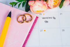 Word Wedding to Reminder Wedding day with Wedding ring on calendar planning. And office tool royalty free stock photos