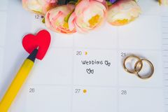 Word Wedding to Reminder Wedding day with Wedding ring on calendar planning. And office tool stock photo