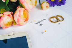 Word Wedding to Reminder Wedding day with Wedding ring on calendar planning. And office tool royalty free stock image