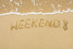 Word Weekend written on sand Royalty Free Stock Images
