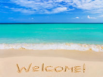 Word Welcome on beach Stock Image