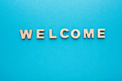Word Welcome on blue background Stock Images