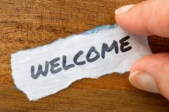 Welcome concept and theme written on old paper on a grunge background. The word Welcome concept and theme written on old paper on a grunge background royalty free stock photography