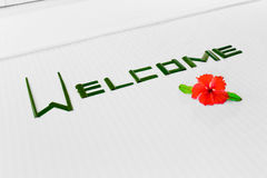 Word Welcome and flower on bed in hotel Stock Photos