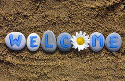 Word Welcome spell out from stones and flower Stock Photography