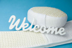 Word welcome on sponge and scrubber - Stock Photo Stock Photo