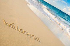 Word welcome writed on a white sand beach Stock Images