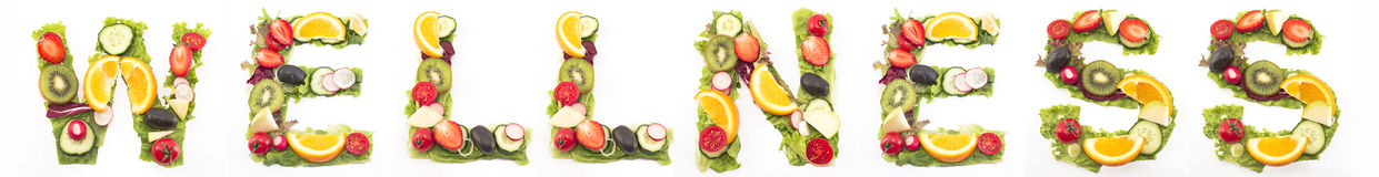 Word Wellness Made of Salad and Fruits Royalty Free Stock Image