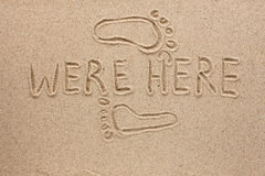 The word were here written on the sand Stock Photos