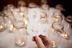Word a white cloth around burning candles. Decoration. Royalty Free Stock Image