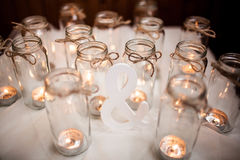 Word a white cloth around burning candles. Decoration. Royalty Free Stock Photography