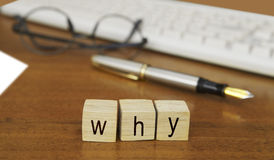 The word why on wood stamp Stock Images
