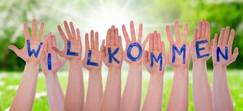 Word Willkommen Means Welcom On Hands, Sunny Meadow Stock Image