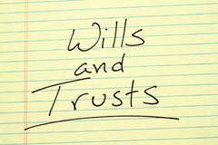 Wills and trusts on a yellow legal pad Royalty Free Stock Photos