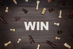Word win on wooden background Royalty Free Stock Images