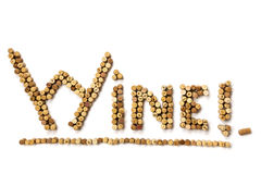 Word Wine made of used wine corks. Closeup of Word Wine made of used wine corks. A random selection of used wine corks, some with vintage years Royalty Free Stock Photography