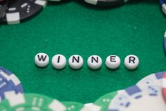 Word `winner` with poker chips and money stock photo