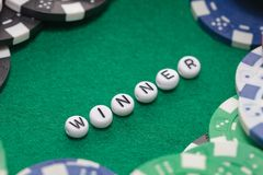Word `winner` with poker chips and money stock images