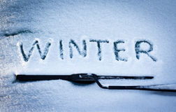 Word Winter on the car glass Stock Images