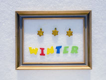 Word winter in the frame on snow Royalty Free Stock Photo