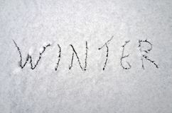 The word `winter` on the snow. Stock Images