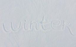 The word winter written on snow background Royalty Free Stock Photo