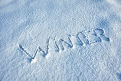Word Winter written in Snow Stock Images