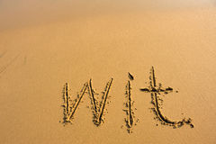 Word wit draw on beach sand Royalty Free Stock Photo