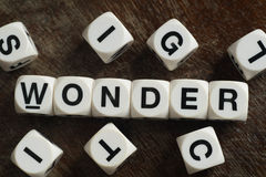 Word wonder on toy cubes. Word wonder on white toy cubes Royalty Free Stock Photo