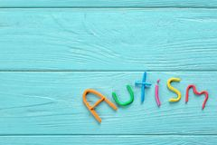Word. `Autism` made of plasticine on color wooden background Royalty Free Stock Photography