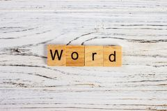 Word word made of round wood blocks on the table Royalty Free Stock Photos