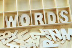 Word words made with wooden letters alphabet. In box royalty free stock images