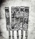 The word WORDS with old. Typewriter hammers with old paper background macro image royalty free stock photography
