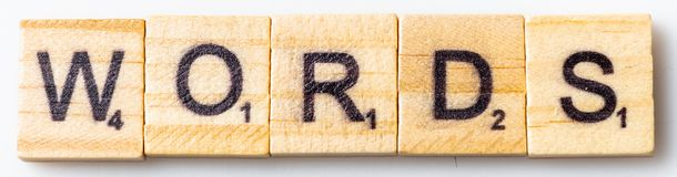 Word WORDS on scrabble tile  letters. Word WORDS on scrabble letters tiles on white background royalty free stock photos