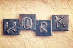 The word WORK made from metal letters Stock Photo
