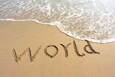 Word world drawn on the beach Royalty Free Stock Images