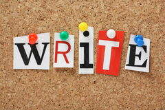 The word Write. In cut out magazine letters pinned to a cork notice board royalty free stock image