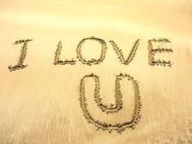 Word writed sur le sable dans la plage de mer Image libre de droits