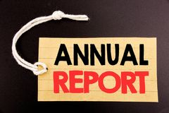 Word, writing Annual Report. Business concept for online sale Analyzing Performance  written on price tag paper on the black vinta. Word, writing Annual Report Stock Image