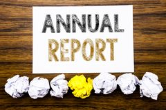 Word, writing Annual Report. Concept for Analyzing Performance  Written on sticky note paper reminder, wooden background with stic. Word, writing Annual Report Stock Photo