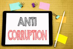 Word, writing Anti Corruption. Business concept for Bribery Corrupt Text Written on tablet laptop, wooden background with sticky n. Word, writing Anti Corruption Royalty Free Stock Photography