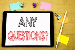 Word, writing Any Questions. Business concept for Answer Help Question Written on tablet laptop, wooden background with sticky not. Word, writing Any Questions Royalty Free Stock Photography