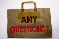 Word, writing Any Questions. Business concept for Answer Help Question Written on shopping bag, white background. royalty free stock photo