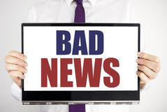 Word, writing Bad News. Business concept for Failure Media Newspaper Written on tablet laptop holding by the man blurred backgroun. Word, writing Bad News Royalty Free Stock Photo