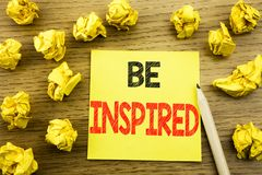 Word, writing Be Inspired. Business concept for Inspiration and Motivation written on sticky note paper on the wooden background. Word, writing Be Inspired Stock Photo
