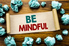 Word, writing Be Mindful. Business concept for Mindfulness Healthy Spirit Written on sticky note paper, wooden background with fol. Word, writing Be Mindful Royalty Free Stock Photos