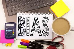Word writing Bias in the office with laptop, marker, pen, stationery, coffee. Business concept for Prejudice Biased Unfair Treatme. Nt Workshop white background Stock Photos