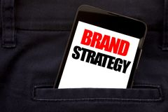 Word, writing Brand Strategy. Business concept for Marketing Idea Plan Written phone mobile phone, cellphone placed in the man fro. Word, writing Brand Strategy royalty free stock images