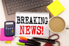 Word writing Breaking News in the office with surroundings such as laptop, marker, pen, stationery, coffee. Business concept for N. Ewspaper Breaking News royalty free stock image