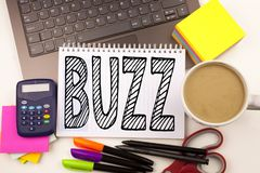 Word writing Buzz in the office with laptop, marker, pen, stationery, coffee. Business concept for Buzz Word llustration Workshop. White background with space Stock Images